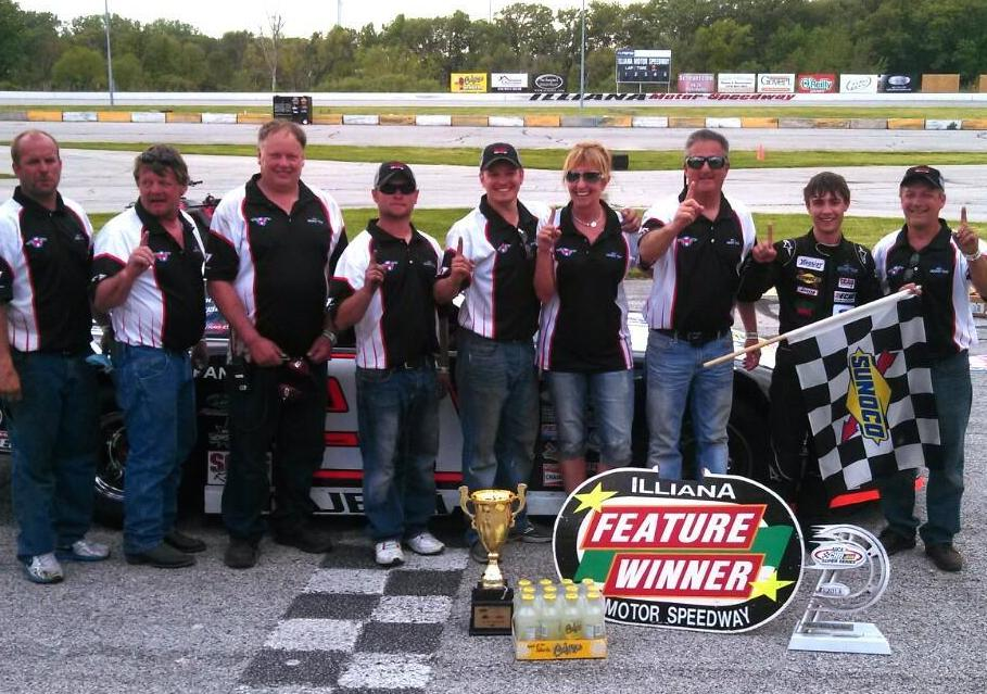 Image of Team M Motorsports in custom pit crew shirts from Captivations Sportswear enjoying the first win of the circuit